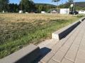 Průlehy na parkovišti v areálu u Hrocha v Komíně